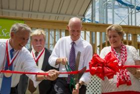 Gov. Rick Scott cuts the ribbon on the new Sand Blaster roller coaster on the Daytona Beach boardwalk. Scott has been traveling the state calling attention to his efforts to boost the economy.