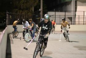 FTL Bike Polo players at night.