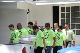 Pallbearers wearing anti-bullying T-shirts carry the casket of Rebecca Sedwick,12, to a waiting hearse as they exit the Whidden-McLean Funeral Home Monday, Sept. 16, 2013, in Bartow, Fla. Polk County Sheriff's Office investigators say they believe Sedwick leaped to her death from a structure at an abandoned cement plant last week following months of bullying.
