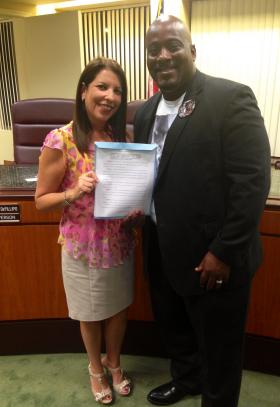 Councilwoman Barbara Kramer and Desmond Meade worked to pass resolution to support voter restoration for felons.