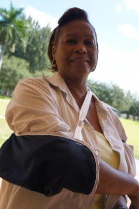 Shirley James who is uninsured, shows off her broken elbow.