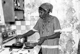 Liliane Nerette-Louis makes beignets in her Miami kitchen in this photo from 1990.