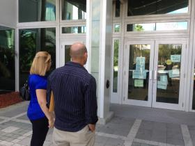 Visitors to Broward County's main IRS office are greeted with locked doors and signs referring them to the agency's website.