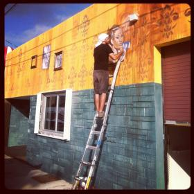 Local artist Krave works on Wynwood Brewing Company's Art Basel mural.