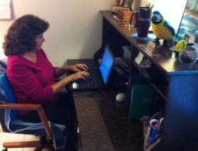 Beatriz Fernandez writes poetry at home for a few hours before heading into work.