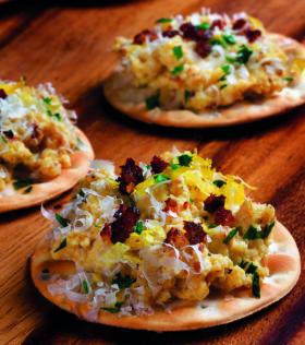Michael Ruhlman suggests a Thanksgivukkah canape of egg ang gribenes spread on crackers