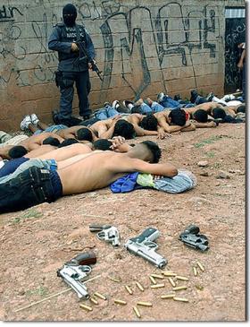 Honduran police arrest Mara gang members in Tegucigalpa.