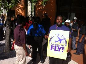 Rashad Grant, a contract worker at the Fort Lauderdale-Hollywood International Airport, joins a rally to demand higher wages for his fellow employees.