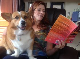 'Dirty Harriet' author Miriam Auerbach reads one of her novels to Elvira, her corgi.