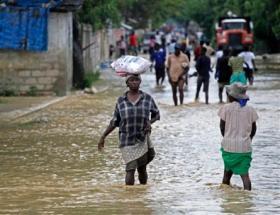 What we dodged this year: Haitians struggle through Hurricane Sandy's devastating floods last year.