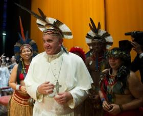 Pope Francis wears an indigenous Pataxo headdress during his visit to Brazil last July for World Youth Day.