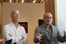 PAMM Director Thom Collins (right) explains the nuts, bolts, bells and whistles behind the museum, alongside architect Jacques Herzon of the firm Herzon and de Meuron.