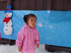 Two-year-old Juno Chen preferred drinking the hot chocolate over playing in the $1,500 snow.