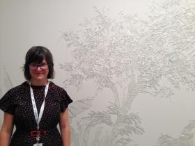 Beth Lipman with her work displayed at Art Miami. Women's work is under-represented in the art world.