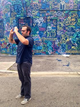 Robert de los Rios takes a photo of street art in Wynwood.