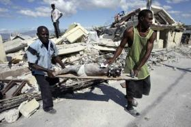 Haitians rescue a child from the rubble of the 2010 earthquake.