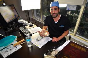 At the intersection of religion and science. Plastic surgeon Dr. Michael Salzhauer in his office on Bay Harbor Islands. The Orthodox Jew attracted controversy after producing a video mocking Jewish stereotypes.
