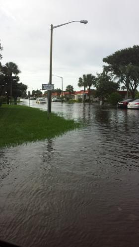 Flooded streets in the Kings Point section of Delray Beach