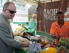 USAID Haiti mission director John Groarke visits Haitian farmers.