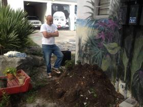 Boynton Beach Arts District founder Rolando Chang Barrero surveys a heap of soil, all that's left of the District's urban garden