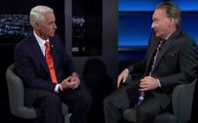 Charlie Crist (left) announces his anti-embargo stance to Bill Maher.