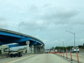 An FHP trooper in one of the few places on 95 Express where the shoulder is wider than eight feet.
