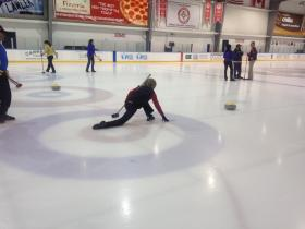 Nancy Watson, co-founder of the Panthers Curling Club based in Coral Springs, throws a curling 'rock.'