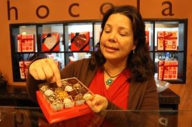 Alejandra Bigai, owner of Romanicos chocolate shop in Miami, shows off her assortment of truffles made from Venezuelan criollo