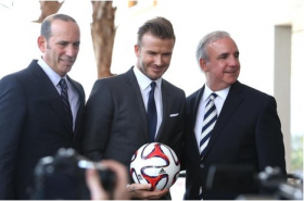 David Beckham, center, poses with Major League Soccer commissioner Don Garber, left, and Miami-Dade County Mayor Carlos Giménez at a press conference at Perez Art Museum to announce his interest in creating an MLS team in Miami.