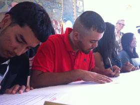 Some of the DREAMers sign their scholar commitment forms