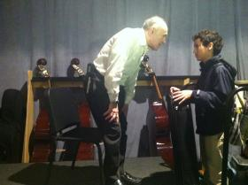 Samuel Marder speaks to a fellow violin player and Miami Arts student after his presentation.