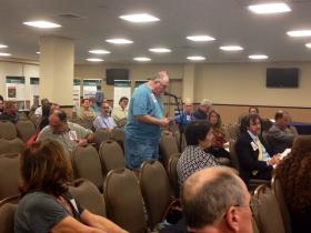 Community member speaks at forum.