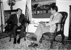 Hugo Chavez (left) talking to Tim Padgett in 2006