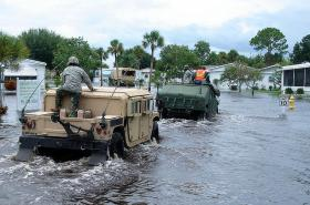 The National Guard evacuates a Melbourne neighborhood flooded after Hurricane Fay. Home buyers in high risk areas can't get mortgages without flood insurance.