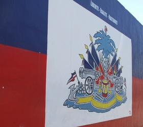 Haitian flag painted by Serge Toussaint on a Little Haiti convenience store.