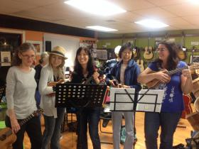 A group of women give in to 'uke fever' at a ukulele meet-up at Penny Lane Music Emporium in Fort Lauderdale.