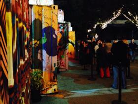 Theater goers lined up outside of the containers waiting to go in and watch their play.