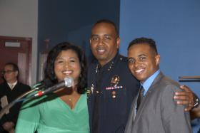 Ian Moffett after being sworn in as Miami Dade Schools Police Chief with his wife and son.