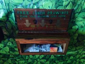 A wall-mounted box at the Flanigan's entrance for the monthly free lunch business card drawing.