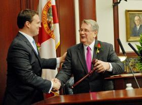 House Speaker Will Weatherford (R-Wesley Chapel), left, shakes hands with Senate President Don Gaetz (R-Niceville).