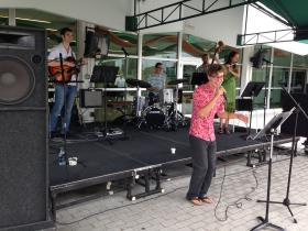 A Brazilian group performs under a tent on the student center patio.