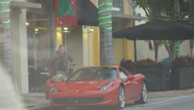 Globovision co-owner Raul Gorrin steps into his Ferrari in Miami.