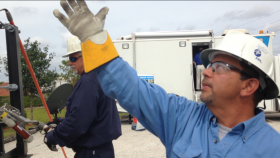 Two linemen demonstrate how they isolate a power outage using the information from smart meters.