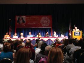 Dr. Nathan Katz introduces the seven panelists at Florida International University's GC ballrooms.