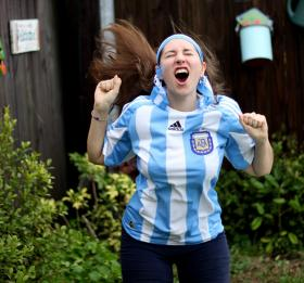 Silvina di Pietro, 24, is a big soccer fan. She is cheering for her country Argentina during the World Cup.