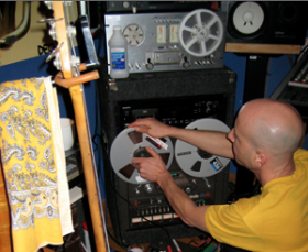Andrew Yeomanson, a.k.a. DJ Le Spam, works the tape machine at his studio.