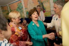 Former state senator Nan Rich speaks with supporters at a local campaign stop.