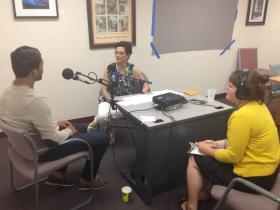 James Garcia sits with StoryCorps facilitator Christina Stanton and Warmamas member Carolina Camps as he shares his military story.