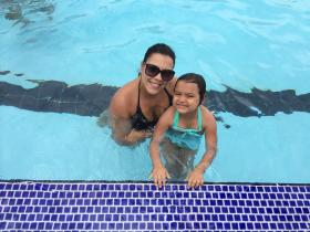 Jaz Rodriguez and her daughter Mara participate in swim lessons at A.D. Barnes public pool.