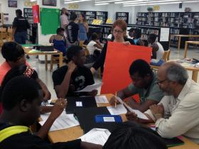 Teacher Sara Weinberg talks Miami Northwestern High School students through an Algebra Project assignment.